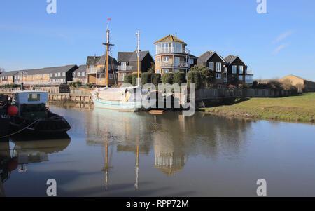 boats moored along faversham creek kent - Stock Photo