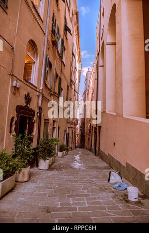 Street with paving stone the od apartments building in the city of Genova, Italy in a hot day of summer - Stock Photo