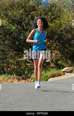 Johannesburg, South Africa - June 25 2009: Young African Girl going for a morning run - Stock Photo