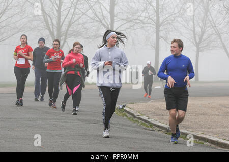Finsbury Park, North London, UK. 23rd Feb 2019. Hundreds of runners take park in 5K Park Run in Finsbury Park, north London in thick fog.   Credit: Dinendra Haria/Alamy Live News - Stock Photo