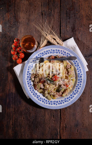 Spaghetti with minced meat zucchini and beans on old table - Stock Photo