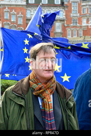 Dominic Grieve MP (Conservative: Beaconsfield) former Attorney General, walking past EU flags on College Green, Westminster, on the day that he was r - Stock Photo