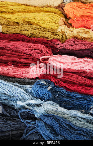 Stacks of Colorful Wool - Stock Photo