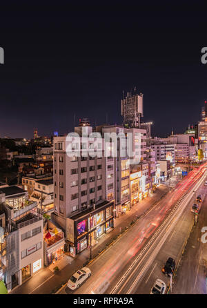 Bird's view of the Japanese youth culture fashion's district crossing intersection of Harajuku Laforet named champs-élysées in Tokyo, Japan at night. - Stock Photo