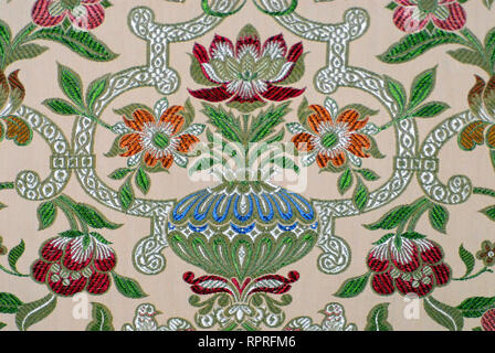 Close up of a beautiful floral pattern of traditional English woven wall covering. - Stock Photo