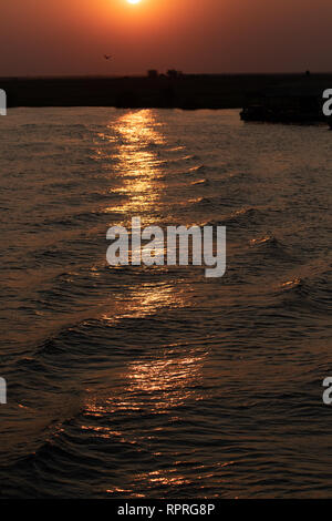 Sunset over the Chobe river in Chobe National Park, on the border of Botswana and Namibia - Stock Photo