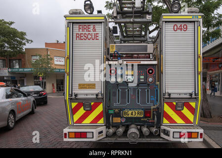 rear view showing the control panel of a New South Wales Fire and Rescue Service fire engine truck parked in Cabramatta, Sydney Australia - Stock Photo