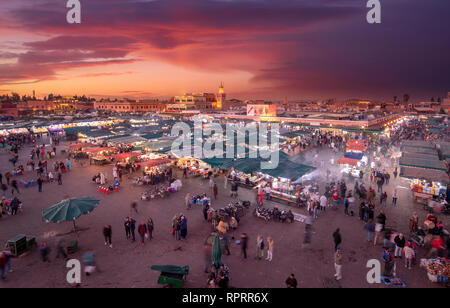 Djemaa el Fna ( Jemaa el Fnaa ) famous Square and market place at sunset. The square in Marrakech medina, Morocco. UNESCO World Heritage site - Stock Photo