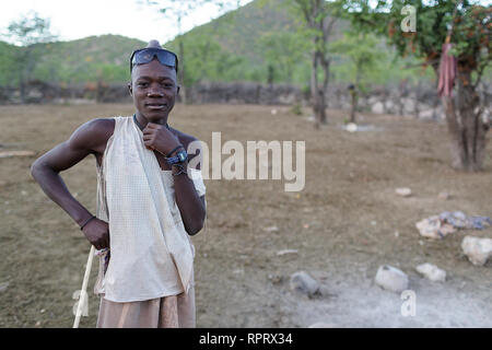 Himba boy herder with a strick, Namibia, Africa - Stock Photo