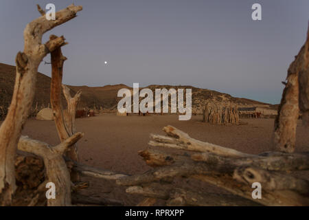 The wooden fence to the Himba village. Purros, Northern Kaokoland, Kaokoveld, Namibia - Stock Photo