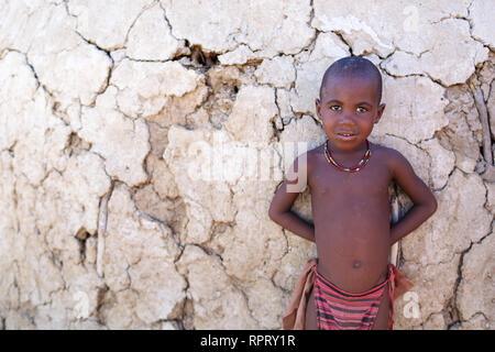 Himba boy, Purros, Namibia, Africa - Stock Photo