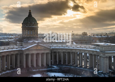 Kazansky Cathedral in St. Petersburg at sunset, winter, the sun shines through clouds, the city panorama, a clear weather, sunshine, colomns, a dome - Stock Photo