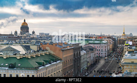 Isaacs Cathedral in St. Petersburg at sunset, Admiralty building, winter, the sun shines through clouds, the city panorama, a clear weather, sunshine - Stock Photo
