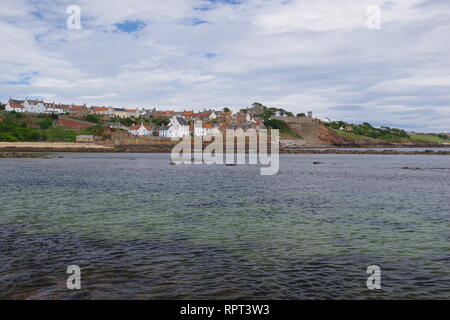 Small Medieval Harbour and Fishing Village of Crail at High Tide, along the Fife Coast in Summer. Scotland, UK. - Stock Photo