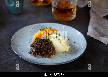 Scottish dish of haggis, neeps and tatties, meal served traditionaly on Burns night - Stock Photo