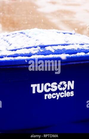Snow on top of a blue recycling trash can in Tucson Arizona - Stock Photo