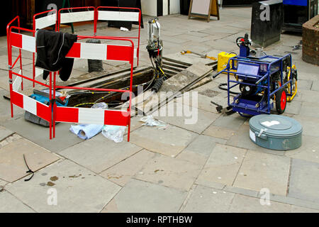 Fibre optic communication cable maintenance at street - Stock Photo