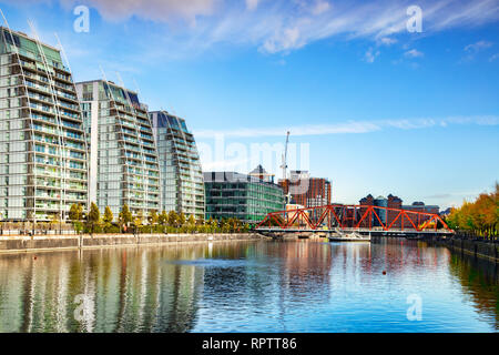 2 November 2018: Salford Quays, Manchester, UK - The Manchester Ship Canal, with the Huron Basin, the Detroit Foot Bridge and the NV apartment buildin - Stock Photo