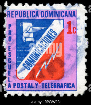 Postage stamp from the Dominican Republic in the Post and telegraph school. Inscription PRO ESCUELA series issued in 1973 - Stock Photo