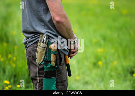 Conservationist with knives on a belt, Kent UK - Stock Photo