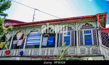 View on Traditional carved balconies and colorful wooden hous in the Old Town of Tbilisi, Georgia - Stock Photo