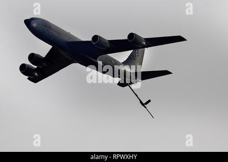 A KC-135 Stratotanker assigned to the 100th Air Refueling Wing conducts a flypast over Endcliffe Park during the Mi Amigo 75th Anniversary flypast event Feb. 22, 2019 at Sheffield, England.Thousands of U.K. residents arrived at the park to honor the memory of the 10 fallen U.S. Airmen who died when their war-crippled B-17 Flying Fortress crash landed to avoid killing residence and nearby children. (U.S. Air Force photo/ Tech. Sgt. Matthew Plew) - Stock Photo