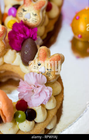 Details of a Easter cake  - Vanilla cake decorated with macaroons and flowers - Stock Photo