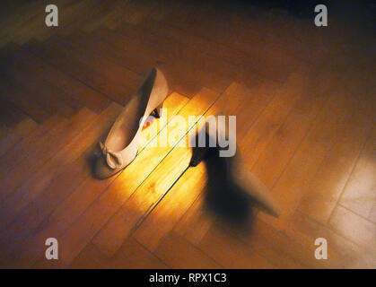 High heel shoes on wooden floor. - Stock Photo