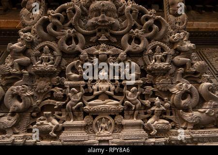 Nepal, Kathmandu, city centre, Jyatha Marg, Chhusya Bahal, ancient carved torana above temple doorway, detail of carving - Stock Photo