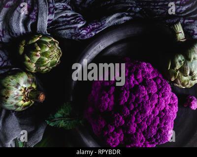 Edgy Purple Cauliflower and Artichokes Dark Photography - Stock Photo