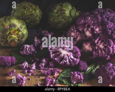 Broken Purple Cauliflower and Artichokes Dark Photography - Stock Photo