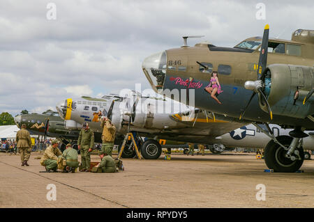 Three Second World War Boeing B-17 Flying Fortress bomber planes lined up at Duxford. World War Two bombers - Stock Photo