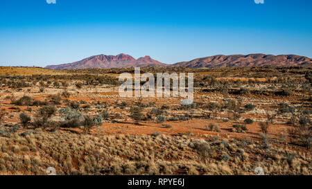 Red centre landscape with distant view of Mount Sonder in NT outback Australia - Stock Photo