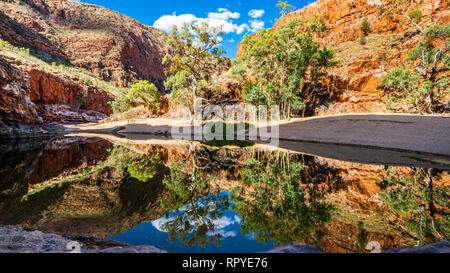 Scenic view of Ormiston gorge water hole in the West MacDonnell Ranges NT outback Australia - Stock Photo