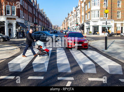 London, UK. 23rd Feb 2019. Britains first 3D Zebra crossing has been installed in St John's Wood, London.  Infrastructure services firm, FM Conway working with Westminster City Council, has installed new three-dimensional road markings on a zebra crossing in order to get drivers to slow down. Similar 3D crossings have been used in Iceland, Australia and India in order to get drivers to slow down. The Zebra crossing is a short walk away from the famous Abbey Road Zebra crossing that the Beatles walked across for the cover of their album 'Abbey Road'. Credit: Tommy London/Alamy Live News - Stock Photo