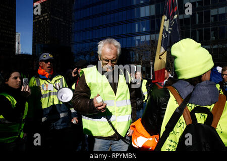 Brussels, Belgium. 23rd February 2019. People take part in a protest march of the yellow vests against government's policy . Alexandros Michailidis/Alamy Live News - Stock Photo