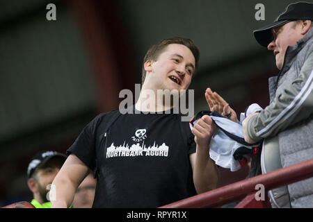 Tynecastle Park, Edinburgh, UK. 23th February 2019. Football. Ladbrokes Premiership league fixture between Hearts and St Mirren; St Mirren fan celebrates at fulltime Credit: Scottish Borders Media/Alamy Live News  Editorial use only, license required for commercial use. No use in betting. - Stock Photo