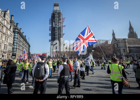 London, UK. 23rd February, 2019. Pro-Brexit protesters calling themselves the 'Yellow Vests UK' movement block roads and traffic whilst protest marching through Westminster. The right-wing nationalists briefly clashed with police and angry drivers whilst aggressively demanding Britain leave the EU without an exit deal. Credit: Guy Corbishley/Alamy Live News - Stock Photo