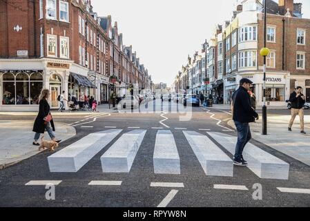 London, UK. 23rd  Feb, 2019. Westminster City Council have installed a 3D Zebra crossing on St John's Wood high street in a bid to slow drivers down and improve pedestrians' safety. Credit: Claire Doherty/Alamy Live News - Stock Photo