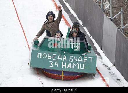 Moscow, Russia. 23rd Feb, 2019. MOSCOW, RUSSIA - FEBRUARY 23, 2019: Participants ride the sledge they have designed for the Battle Sani creative sledge festival in Moscow. Artyom Geodakyan/TASS Credit: ITAR-TASS News Agency/Alamy Live News