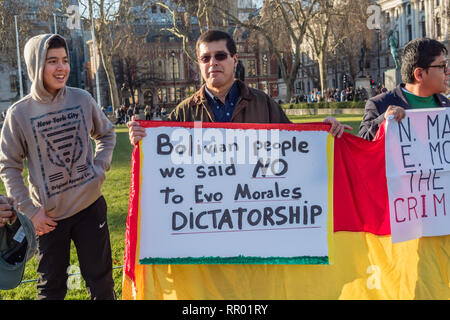 London, UK. 23rd February 2019.  Bolivians protest in Parliament Square against President Evo Morales, saying he is a dictator and accuse him of corruption and interfering with the court system to remain in power. Bolivia's Electoral Tribunal ruled in December that he could stand for a fourth term in office in the November 2019 elections, despite a referendum on 21st Feb 2016. which narrowly rejected changing the 2009 constitution to allow the President to serve more than two consecutive terms. Peter Marshall/Alamy Live News - Stock Photo