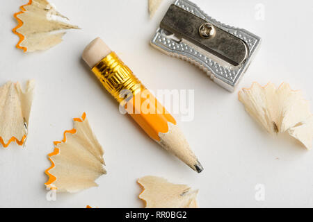Used short pencil and sharpener - Stock Photo