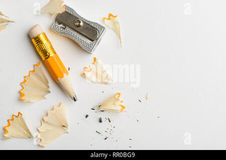 Used pencil, shavings and sharpener - Stock Photo