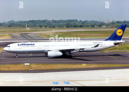 Passenger aircraft Airbus A330-300 Lufthansa German airlines before takeoff on a runway of an airport in Germany - Stock Photo