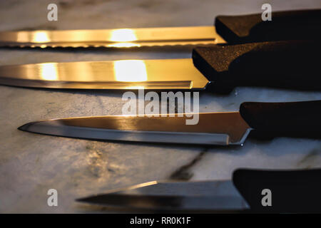 4 knives on a table,  kitchen utensil, chef - Stock Photo