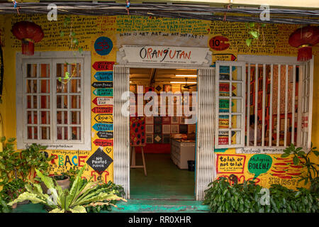 Melaka, Malaysia - December 2018: Orangutan House, art gallery and t-shirt shop in the old Malacca city. - Stock Photo