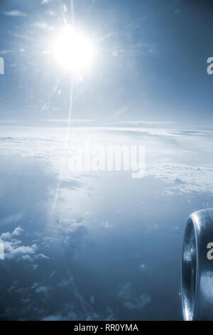 View from the airplane window into the white clouds - Stock Photo