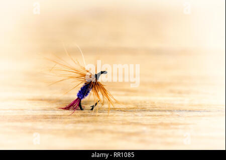 Lures flying for fishing close-up in retro style - Stock Photo