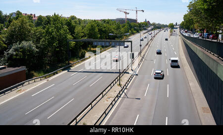 Road traffic on a freeway in the city center of Berlin - Stock Photo