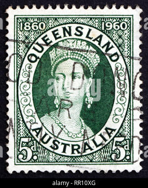 AUSTRALIA - CIRCA 1960: a stamp printed in the Australia shows Queen Victoria, Centenary of the first Queensland Stamps, circa 1960 - Stock Photo